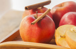Red winter apples with cinnamon sticks Stock Images