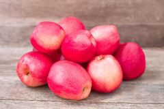 Red winter apples. Old polish sort on wooden stock images