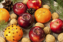 Red winter apples with walnuts Royalty Free Stock Image