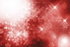 Red winter background. With defocused lights and snowflakes Royalty Free Stock Image