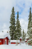 Red winter cottages portrait Stock Photo