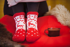 Red winter feeling with a cup of coffee. Sock Royalty Free Stock Photography