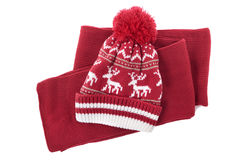 Red winter knit hat and scarf isolated on white background Royalty Free Stock Images