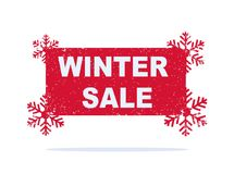 Red winter sale sticker with snowflakes. Stock Photos