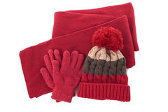 Red winter wool knit hat, scarf and gloves isolated on white background Royalty Free Stock Photos