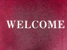 Red wipes with welcome words. Red wipes with welcome words white color royalty free stock photography