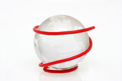 The red wire with crystal globe. Isolated in white Royalty Free Stock Photos