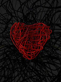 red wire heart and black wire background Stock Photos