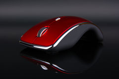 Red wireless mouse on dark reflecting background Stock Photo