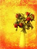 Red withered rose bouquet on grungy orange painted wall. Stock Photo