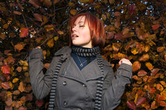 Red woman with autumn leaves Royalty Free Stock Image