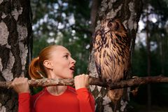 Red woman with big owl Stock Photo