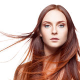 Red woman with blowing hair Royalty Free Stock Image
