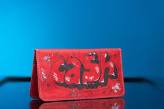 Red woman clutch bag. with the words cash Royalty Free Stock Photo