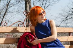 Red woman enjoying sunny day Stock Image