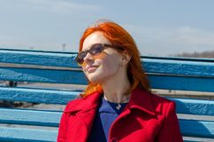 Red woman enjoying sunny day Royalty Free Stock Photo