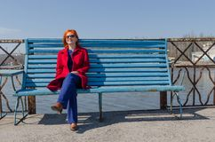 Red woman enjoying sunny day Stock Photography