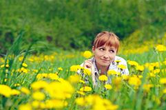 Red woman on the grass Royalty Free Stock Photo