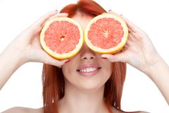 Red woman holding grapefruit Royalty Free Stock Images