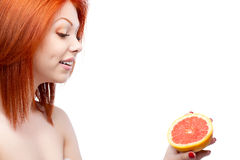 Red woman holding grapefruit Stock Photos