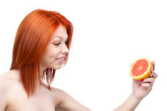 Red woman holding grapefruit Stock Images
