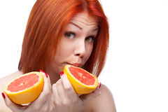 Red woman holding grapefruit Stock Photo