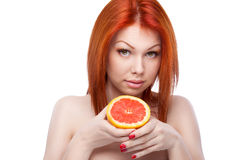 Red woman holding grapefruit Royalty Free Stock Photography