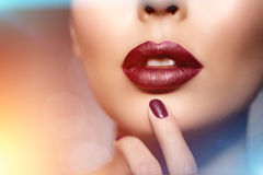 Red woman lips close up. Beautiful model girl with lipstick, man Royalty Free Stock Photography