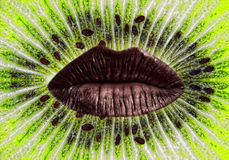 Red woman lips on ripe green kiwi slice background. Royalty Free Stock Photo