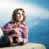 Red woman lying on rocks Royalty Free Stock Photos