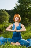 Red woman meditating outdoors Stock Photos
