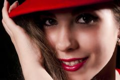 Red woman portrait. Nice and elegant young woman with a red hat, smiling Stock Photos
