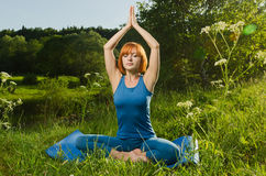 Red woman practicing fitness yoga royalty free stock images