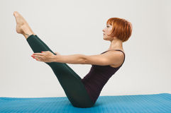 Red woman practicing fitness yoga Stock Images