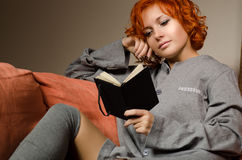 Red woman reading Stock Image
