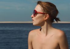 Red woman at the sea Stock Image