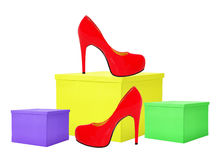 Red woman shoe and yellow gift box isolated on white Royalty Free Stock Photos