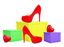 Red woman shoe and yellow gift box isolated on white Royalty Free Stock Images