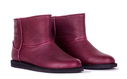 Red woman shoes on the white background. Autumn boots for women with real leather Stock Photos