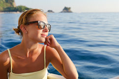 Red woman on a yacht cruise Royalty Free Stock Photography