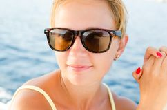 Red woman on a yacht cruise Royalty Free Stock Images