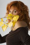 Red woman and yellow fall leaves Stock Photography
