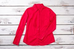 Red women long-sleeve blouse. Royalty Free Stock Photos