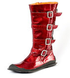 Red women's boots genuine leather, metal buckles. Attractive fashionable red boots, Shoes from a genuine leather on a poliuretanovy sole. man's, female, children Royalty Free Stock Photos
