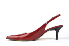 Red Women's High-Heel Shoe. Side shot of one red women's high-heel dress shoe against white background Royalty Free Stock Photos