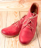 Red women's leather shoes with laces on  wooden background Stock Photo