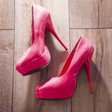 Red women shoes on wooden background. Stock Images