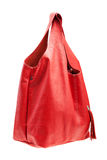 Red womens bag  on white background. Stock Photo