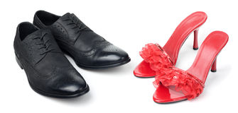 Red womens and black mens shoes Stock Images