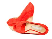 Red womens shoes. Womens suede red shoes isolated on white background stock images